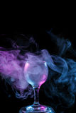 Blue and purple smoke in the glass. Halloween. Royalty Free Stock Images