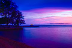 Blue purple sunset at the tropical quiet beach royalty free stock photo