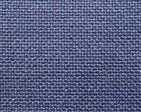 Blue purple woven fabric background. Woven fabric background with a mixture of blue and purple threads Royalty Free Stock Image