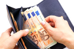Blue purse with euros in the hands on white background Royalty Free Stock Photography