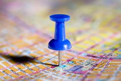 Blue pushpin on the map Stock Images
