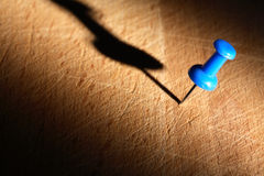 Blue Pushpin On Wood Royalty Free Stock Photography