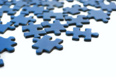 Blue puzzle. Isolated over white background stock image