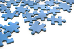 Blue puzzle. Isolated over white background Royalty Free Stock Photo