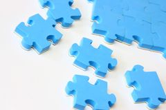 Blue puzzle. Close-up isolated on a white background Stock Photos