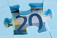 Blue puzzle on Euro currency. Hidden assets concept. Blue puzzle on Euro currency Royalty Free Stock Photography