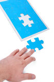 Blue puzzle and hand stock photos