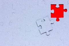 Blue puzzle with missing piece. In a red color Stock Image