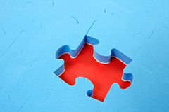 Blue puzzle with one piece missing stock images