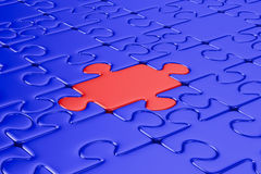 Blue puzzle and one red. Isolated 3D. Image Royalty Free Stock Photos