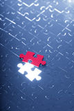 Blue puzzle with one red piece Stock Photos