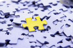 Blue puzzle with one yellow element Stock Photo