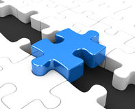 The blue puzzle piece Stock Images