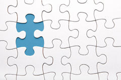 Blue puzzle piece missing. Puzzle piece missing on blue background stock photography