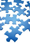 Blue puzzle pieces Stock Image