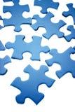 Blue puzzle pieces. A background of blue puzzle pieces Stock Image