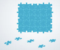Blue puzzle pieces. On gray gradient background Stock Images