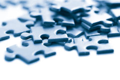 Blue puzzle pieces isolated Stock Image