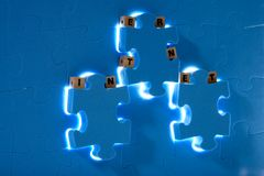 Blue puzzle with  wood letter Stock Photography