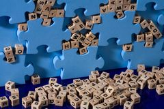 Blue puzzle with wood letter stock photo