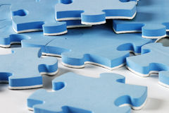Blue puzzles. Elements close-up Royalty Free Stock Photo