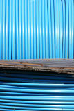 Blue pvc long tube on  spool Royalty Free Stock Images