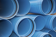 Blue PVC municipal water irrigation pipe line pile Royalty Free Stock Photo