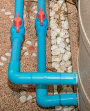Blue PVC pipe and  valve to Water pump Stock Photo