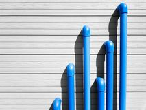 Blue PVC pipes on the grey background Stock Photography