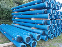 Blue PVC plastic pipes and fittings used for underground water supply and sewer lines Stock Photos