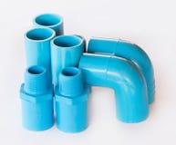 Blue pvc plumbing fittings Royalty Free Stock Photos