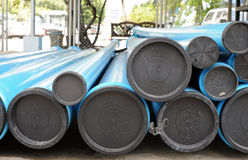 Blue PVC water pipes with covers in the stack Stock Images
