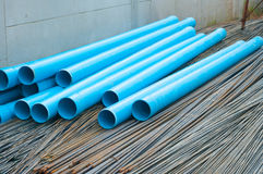 Blue PVC water pipes and Steel rod. Stacks of blue PVC water pipes and Steel rod Stock Images