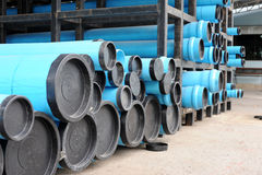 Blue PVC water pipes in the storage Royalty Free Stock Photos