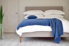 Blue quilt. Blue textured bedding quilted material / throw / quilt royalty free stock image