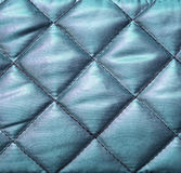 Blue quilted fabric Royalty Free Stock Images