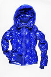 Blue quilted jacket. On white background Royalty Free Stock Image