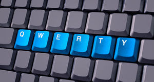 Blue qwerty button on keyboard. Close-up stock photo