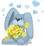 Blue rabbit  with daisy flowers Stock Photos