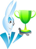 Blue rabbit with shiny trophy Royalty Free Stock Photo