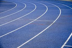 Blue racetracks with white markings. Specialized coating for running Royalty Free Stock Image