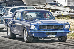 Blue racing car side view Royalty Free Stock Image