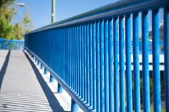 Blue railing of footbridge Royalty Free Stock Images