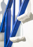 Blue railing and white stairs Royalty Free Stock Image