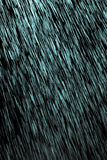 Blue rain on a black background. Photo texture Stock Photo