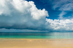 Blue rain clouds hover over the calm sea Royalty Free Stock Images