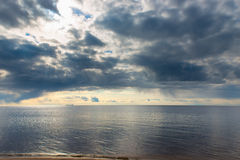 Blue rain clouds over a sea Royalty Free Stock Photo