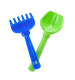 Blue rake and green spade Stock Image