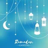 Blue Ramadan Kareem celebration greeting card. Hanging arabic lamp, Stock Photo