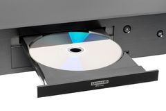 Blu-ray player. Blue-ray player with a disk, isolated Stock Photography